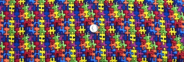 Puzzle piece fabric. Red, blue, yellow, purple and green puzzle pieces. Autism Awareness by Baum 19596 - Fabric by the yard