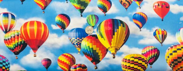 Colorful hot air balloons all over blue sky and clouds. Everyday Favorites by Robert Kaufman 19171 - fabric by the yard