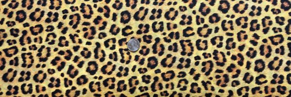 "Leopard animal print ""cotton lawn"". Orange and yellow tones. Animal Kingdom Lawns by R. Kaufman 19962 - One yard of fabric."