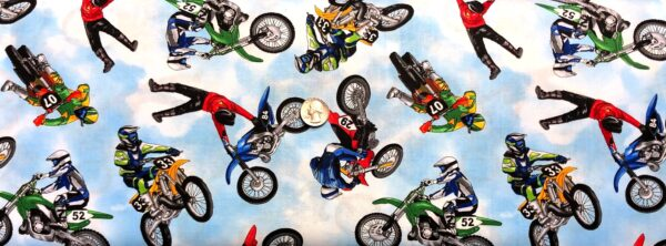 Multicolored Motocross bikes all over sky blue. Dirt bike fabric. Multi by Timeless Treasures c8993 - Fabric by the yard