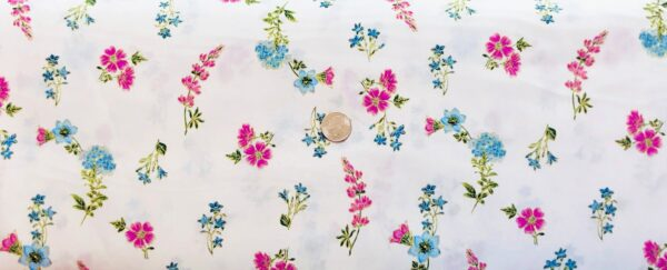 Pink and blue flowers with metallic gold accents all tossed on white. Field of Dreams by Kanvas 8939 - Fabric by the yard