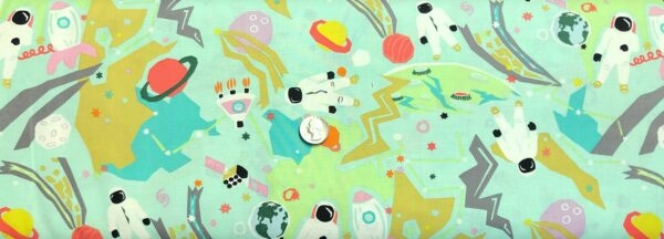 Alexander Henry 8621 C Outer Space. Astronauts and rockets in pastels all over mint green. Fabric by the yard