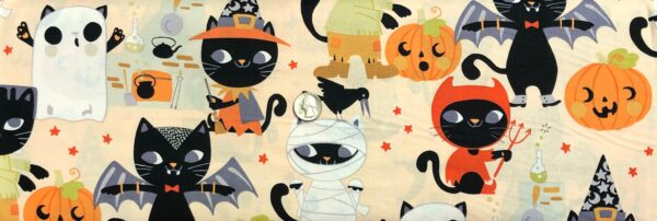 Alexander Henry 8829 Haunted House. Black cats dressed up for Halloween all over peach. Fabric by the yard