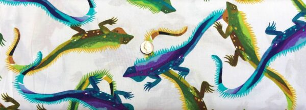 Alexander Henry - I Wanna Iguana. Green, purple and yellow iguanas all over white. 8812 A - Fabric by the yard.