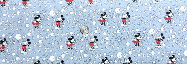 Mickey and Minnie Mouse all over light blue with popping bubbles. Mickey and Minnie Bubbles by Springs 20160Fabric by the yard.
