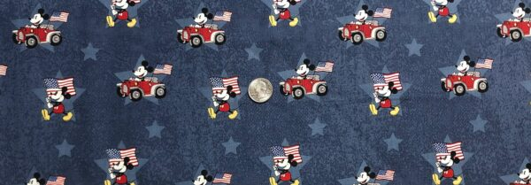 Mickey Mouse in red convertible w American flag all over blue. Patriotic Mickey by Springs 20034 - Fabric by the yard
