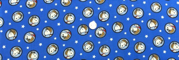 Snoopy the aviator on royal blue. Snoopy Red Baron Badges by Springs Creative 20140 - Fabric by the yard