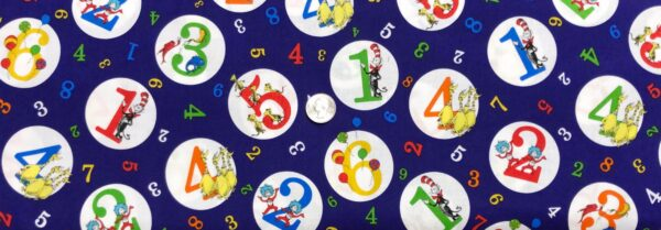 Dr. Seuss colorful numbers in circles all over purple printed on Kona cotton. Dr. Seuss 123 by R. Kaufman 74437 - Fabric by the yard.
