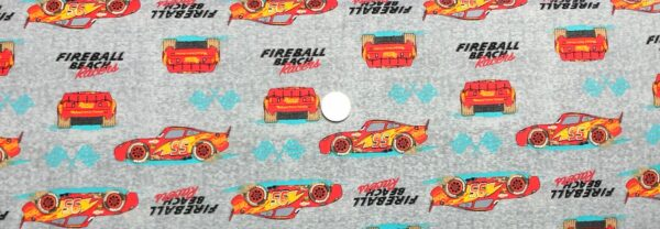 Lightning McQueen #95 in stripes with teal flags on tonal grey. Fireball Racer by Springs Creative 19325 - Fabric by the yard.