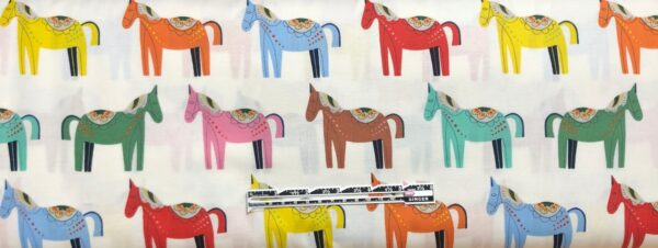Folkloric horses all over white. Folkloric Carita Caballo by Alexander Henry 8809 A - fabric by the yard