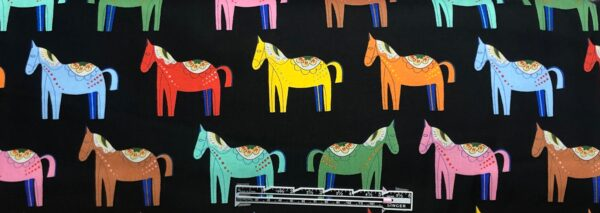 Folkloric horses all over black. Folkloric Carita Caballo by Alexander Henry 8809 C - fabric by the yard