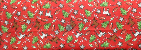 Christmas sugar cookies all over red. Reindeer, Christmas trees and more. Reindeer Antics by QT 27218 R - fabric by the yard