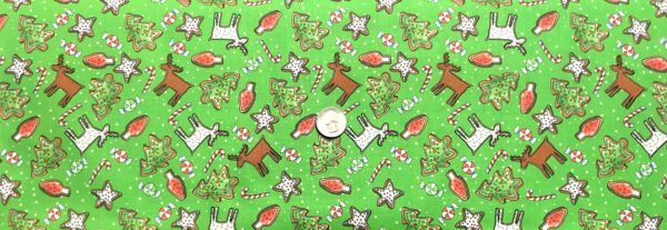 Christmas sugar cookies all over green. Reindeer, Christmas trees and more. Reindeer Antics by QT 27218 B - fabric by the yard