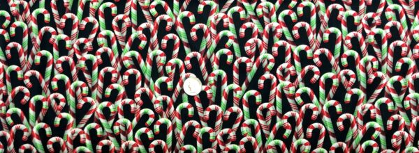 Christmas candy canes in peppermint and wintergreen all over black. Jolly Saint Nick by R. Kaufman 18889 - fabric by the yard