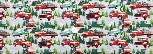 Christmas trees in red trucks and jeeps all over grey snowy scenic. The Tradition Continues by Henry Glass 9101 - fabric by the yard