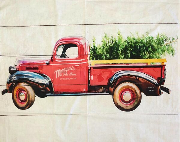Christmas tree in red truck on wood panel background. Loads of Cheer by Springs 20063 - fabric by the yard