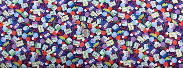 Glitter, buttons, beads, yarn, poms and more all over purple. Crazy for Crafting by Quilting Treasures 26971 - Fabric by the yard.