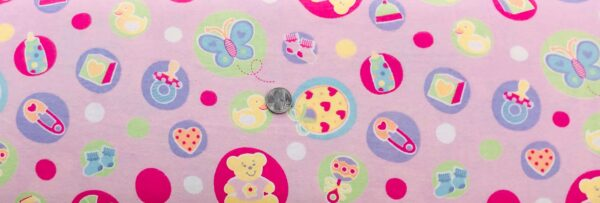 Flannel!! Teddy bears, pacifiers, rattles and bottles all over pink. MDG - Fabric by the yard