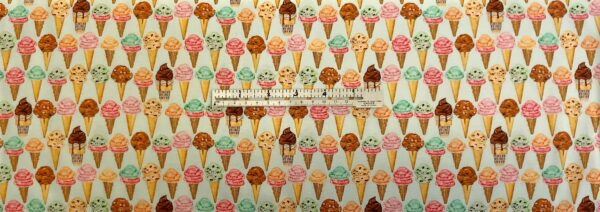 Delicious Ice Cream on the cone all over light mint green. Sweet Tooth by R. Kaufman 19829 - Fabric by the yard.