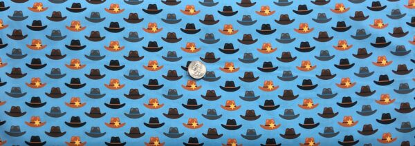 Cowboy hats in brown, black and grey patterned all over blue. Cowboy Coyote by R. Kaufman 18545 - 1 yard of fabric