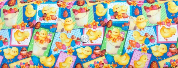 Easter chicks and chocolates all over teal blue. Easter Parade by Quilting Treasures 27580 - Fabric by the yard.