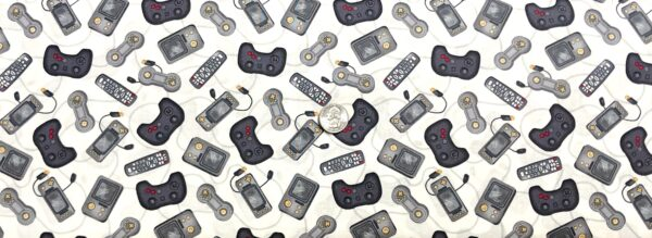 Video game controllers and remote controls all over cream/white. Man Cave by Windham Fabrics 52415 - 6 Fabric by the yard.