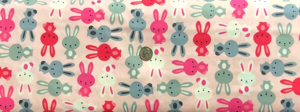 Easter bunnies in pinks, grey and white all over light pink. Urban Zoologie by R. Kaufman 14721 - Fabric by the yard