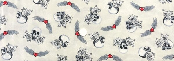 Skulls, roses and wings with hearts all over off white leather look. Born to Ride by Windham Fabrics 52241 1 - One yard of fabric.