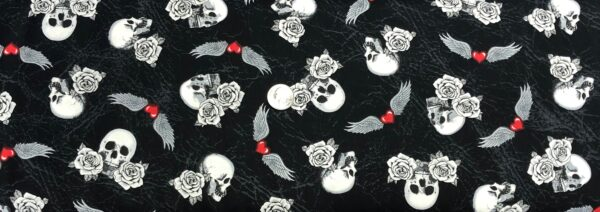 Skulls, roses and wings with hearts all over black leather look. Born to Ride by Windham Fabrics 52240 3 - One yard of fabric.