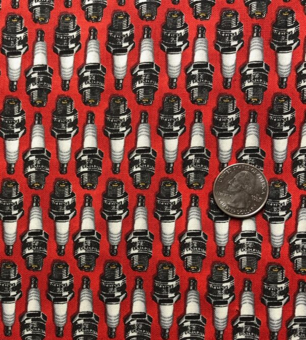 Spark plugs in a row on red. Born to Ride by Windham Fabrics 52242 5 - One yard of fabric.