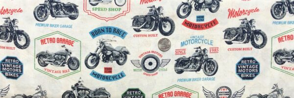 Motorcycles and motorcycle signs all over off white leather look. Born to Ride by Windham Fabrics 52240 1 - One yard of fabric.