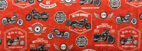 Motorcycles and motorcycle signs all over red leather look. Born to Ride by Windham Fabrics 52240 5 - One yard of fabric.