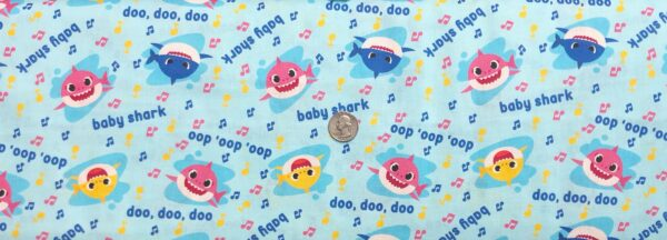 Baby Shark with music notes all over light blue. Baby Shark Music Toss by Springs 20232- Fabric by the yard