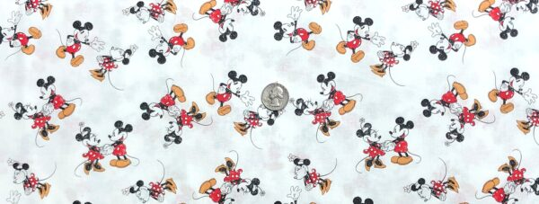Mickey and Minnie Mouse scattered all over white. Mickey and Minnie Scattered by Springs 20218 Fabric by the yard.