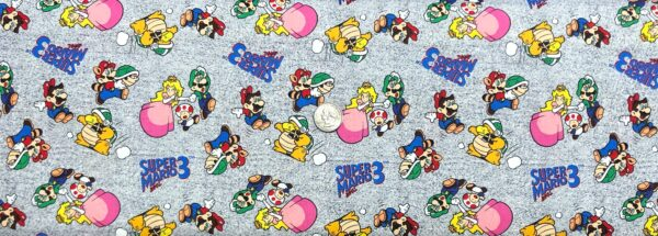 Mario Bros 3! Mario, Luigi, Princess Peach and Toad toss on grey speckled. Super Mario Badge by Springs 20264 - Fabric by the yard