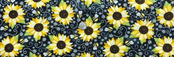 Sunflowers and bees all over black. Bright yellow sunflowers and bees all over. Gail - Black Timeless Treasures C5345 - Fabric by the yard