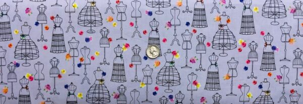 Dress forms and flowers all over lavender. Amour De Fleur by QT 27054 L - fabric by the yard
