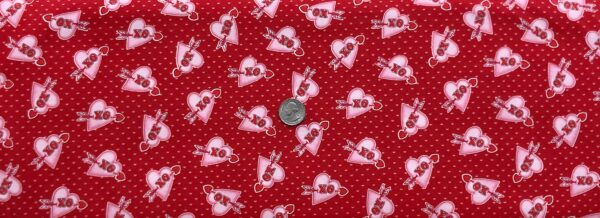 Sweet little pink hearts with XO and red arrows on red. Love Struck by Henry Glass 1368 - Fabric by the yard