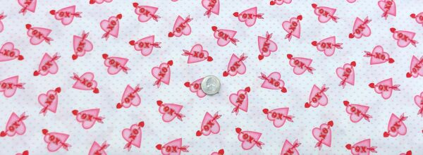 Sweet little pink hearts with XO and red arrows . Love Struck by Henry Glass 1368 - Fabric by the yard
