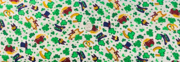 St. Patricks Day fabric. Leprechaun hats, horse shoes, harps, gold and clovers all over white. Spring Industries 2004 - 1 yard of fabric