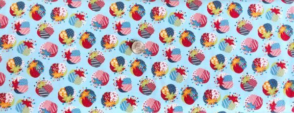 Crafty decorated pin cushions in red, blue, green and more all over light blue. Crafty Studio by Studio E 4584 - fabric by the yard