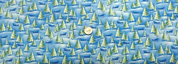 Snowy scene with sleds and pine trees all over snowy blue. Woodland Cuties by Quilting Treasures 27115 - Fabric by the yard.