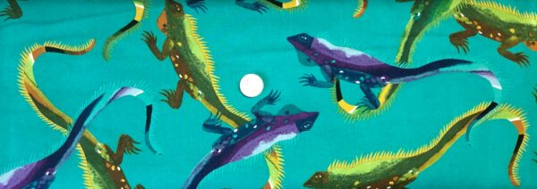Alexander Henry - I Wanna Iguana. Green, purple and yellow iguanas all over teal. 8812 B - Fabric by the yard.