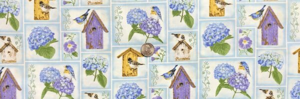 Multicolor wooden birdhouses with birds and flowers in blue shadow squares. Hydrangea Birdsong by Henry Glass 1759 - Fabric by the yard