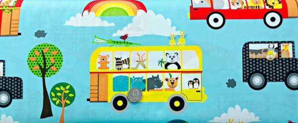 Cartoon zoo animals in buses and jeeps on beautiful sky blue background. On the Road by Quilting Treasures - 26193 - Fabric by the yard