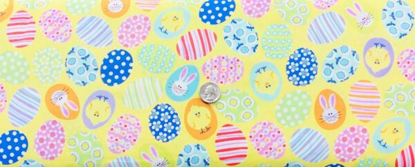 Colorful Easter eggs on beautiful pale yellow. Funny Bunnies by Kanvas Studios 08541 - Fabric by the yard.Colorful