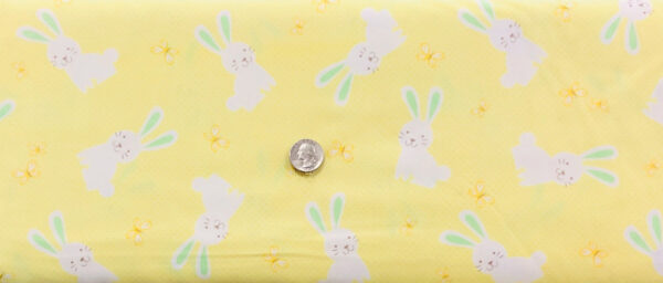 Easter bunnies in white with green ears on beautiful pale yellow. Bunny Hop by Kanvas Studios 08078 - Fabric by the yard.