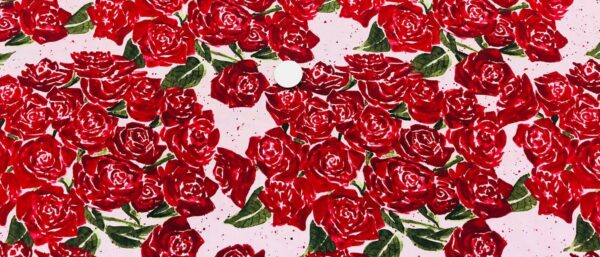 Watercolor red roses on baby pink background with small red and green speckles. Heartfelt by Clothworks Y1832-41 - Fabric by the yard.